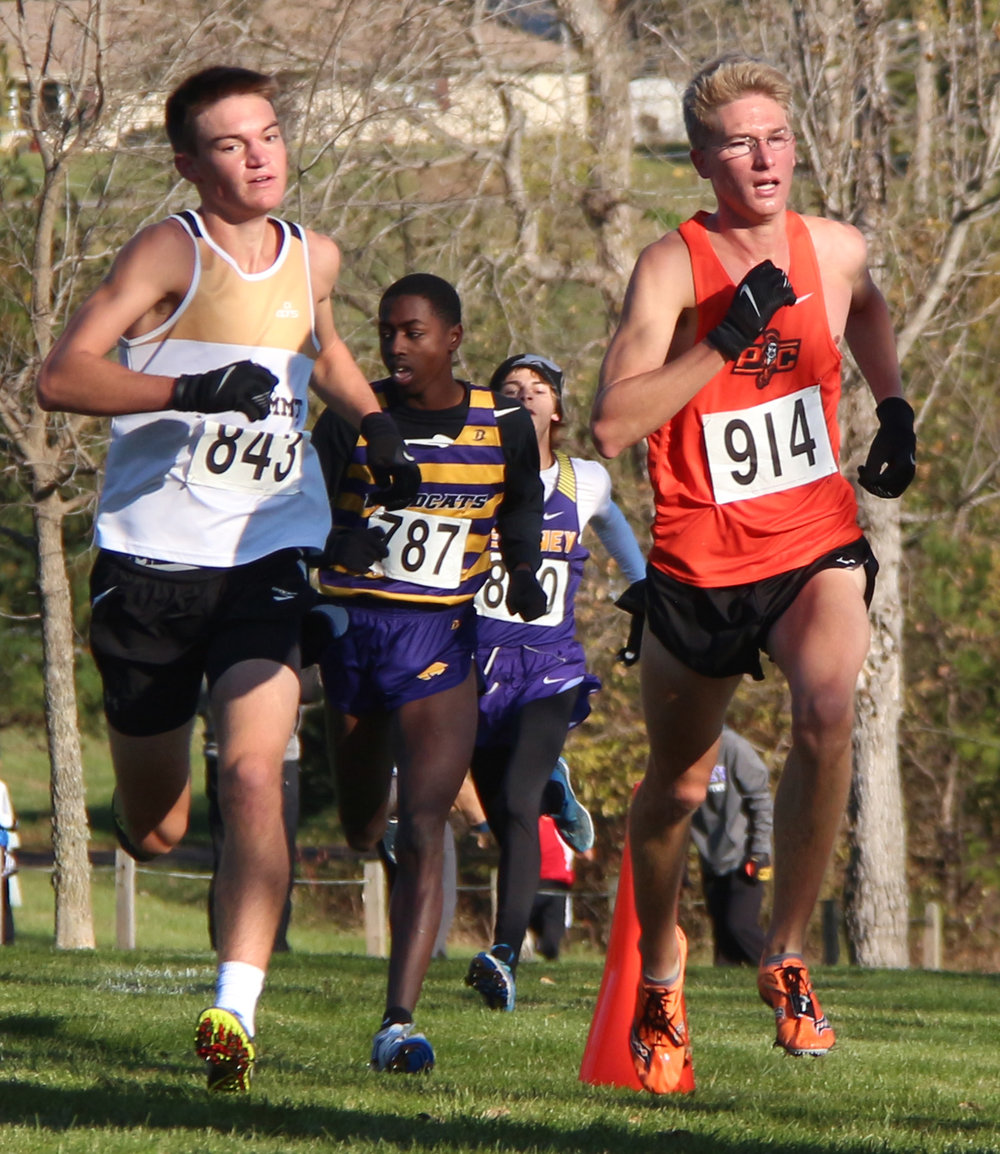 ROSS MARTIN/Citizen photo Platte County senior Nick Bjustrom, right, leads a large pack of runners up the final hill.