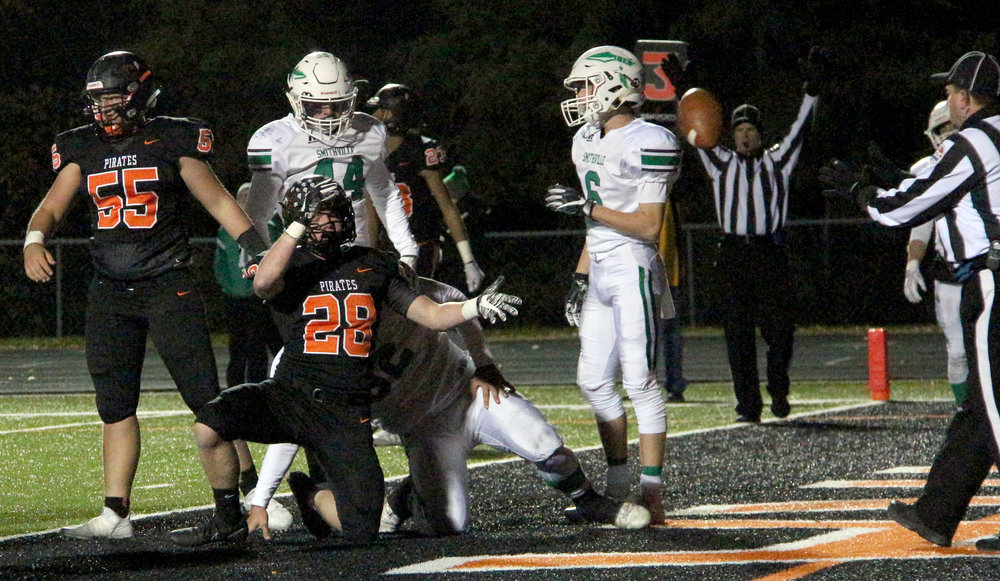 ROSS MARTIN/Citizen photo Platte County senior Dakota Schmidt (28) tosses the ball to a referee after scoring a rushing touchdown in the second half of a Class 4 District 8 semifinal win over Smithville on Friday, Oct. 27 at Pirate Stadium.