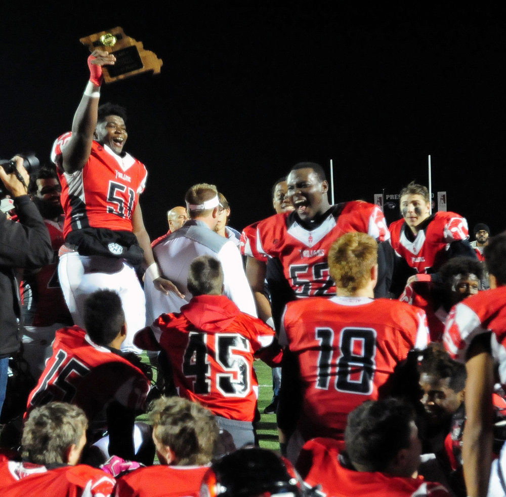 NICK INGRAM/Citizen photo Park Hill senior offensive lineman Jaleel Brazil holds up the Class 6 District 4 championship plaque after a 28-14 win over Rockhurst on Friday, Nov. 3 at Park Hill District Stadium.
