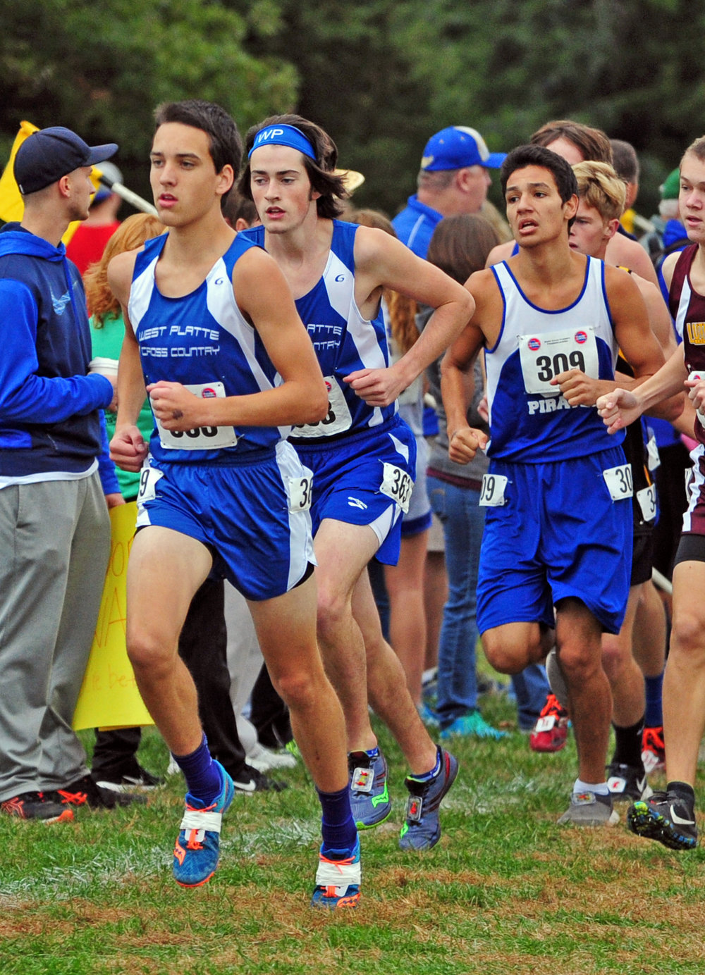 NICK INGRAM/Citizen photo West Platte sophomore Phillip Pattison, left, and senior Andrew Cicha, center, run in a pack during the race.