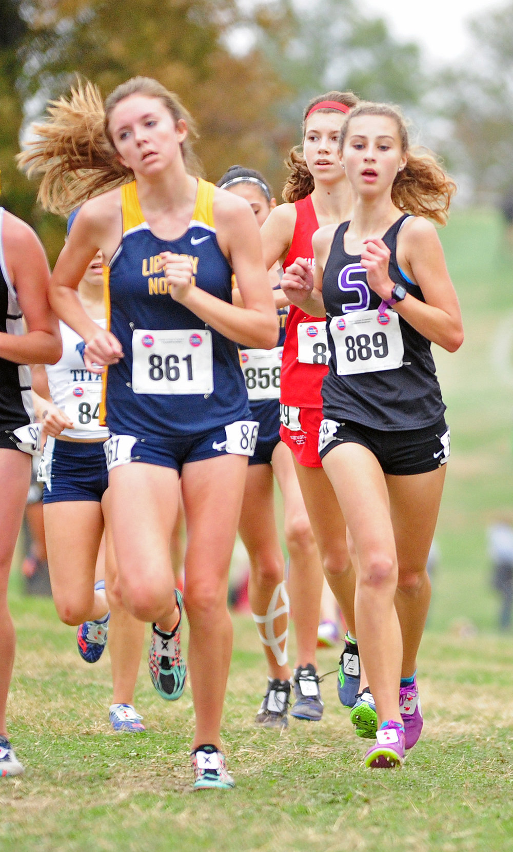 NICK INGRAM/Citizen photo Park Hill South sophomore Paige Snider, right, runs in a pack during her Class 4 Missouri State Cross Country Championships debut Saturday, Nov. 4.