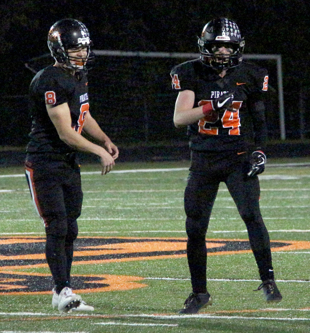 ROSS MARTIN/Citizen photo Platte County seniors Hunter Tongate, left, and JP Post celebrate a pass breakup in the Class 4 District 8 title game Friday, Nov. 3 at Pirate Stadium.
