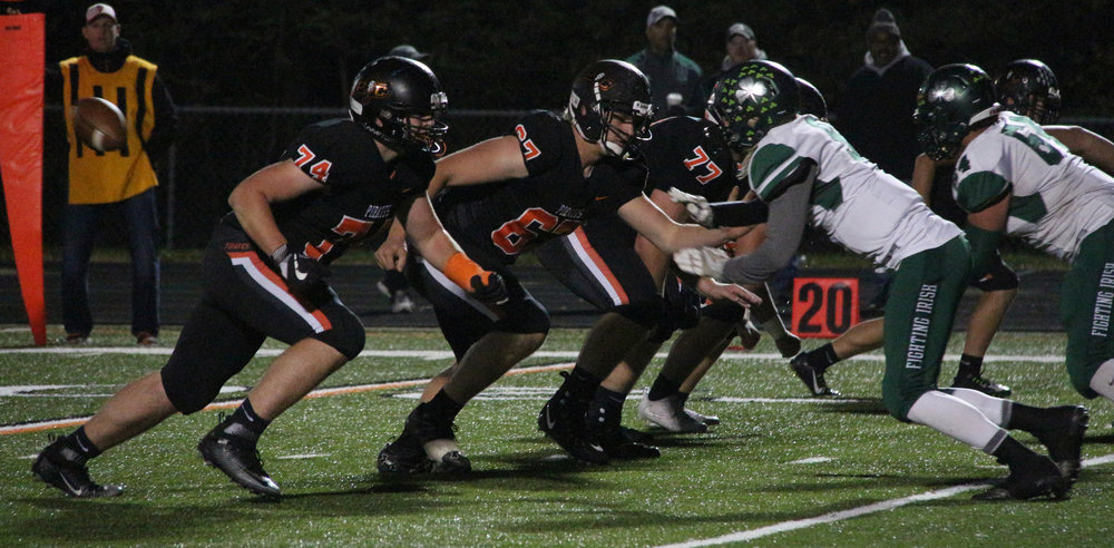 ROSS MARTIN/Citizen photo Platte County offensive linemen (from left) junior Reid Sutter, senior Matthew Knopp and senior Trevor Tietz move upfield after a snap against Lafayette on Friday, Nov. 3 at Pirate Stadium.