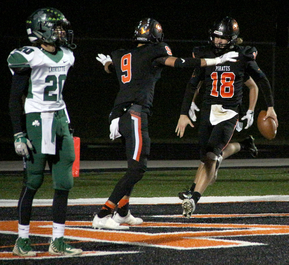 ROSS MARTIN/Citizen photo Platte County senior quarterback Tanner Clarkson (18) celebrates his first half touchdown run with junior wide receiver Dylan Gilbert on Friday, Nov. 3 at Pirate Stadium.