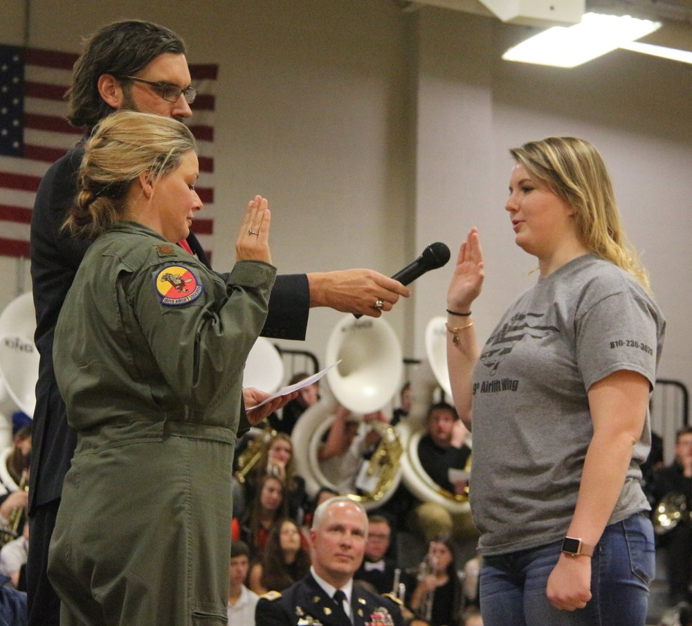 ROSS MARTIN/Citizen photo Platte County senior Sara White (right) also took an enlistment oath for the Air National Guard during the ceremony.