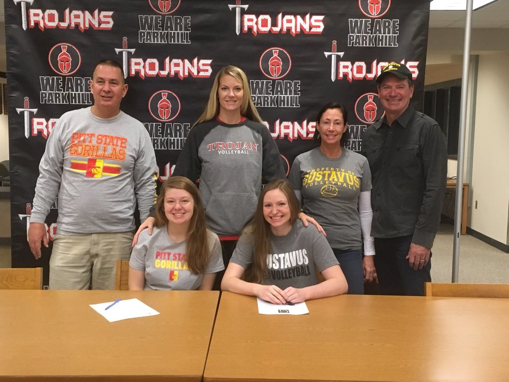 Contributed photo Park Hill seniors (front row, from left) Madison Michaelis and Kai Welsh were honored during a morning signing ceremony Wednesday, Nov. 8 at Park Hill High School in Kansas City, Mo.