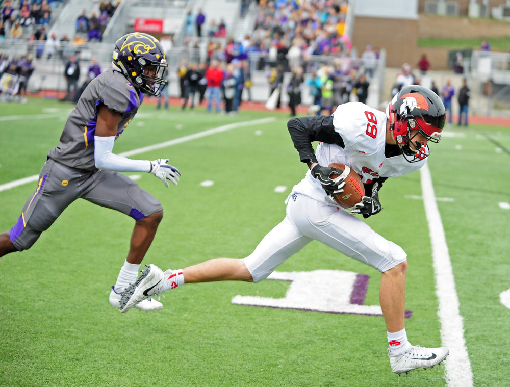 NICK INGRAM/Citizen photo Park Hill junior Payton Stanfield, right, hauls in a 39-yard touchdown pass in a Class 6 semifinal against Blue Springs on Saturday, Nov. 11 in Blue Springs, Mo.