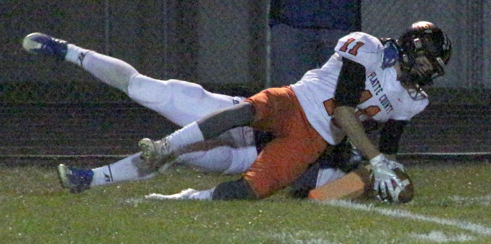 ROSS MARTIN/Citizen photos Platte County senior wide receiver Devin Richardson dives into the end zone for a first half touchdown in a Class 4 quarterfinal against Moberly on Friday, Nov. 10 in Moberly, Mo.