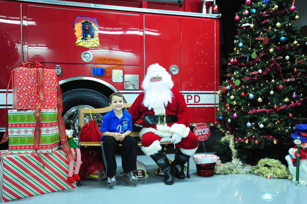 Citizen file photo The City of Dearborn will host a pair of holiday celebrations this weekend with Christmas in Dearborn taking place at the Dearborn Community Center and Cookies with Santa at the Dearborn Area Fire Protection District Station. This photo comes from last year's Cookies with Santa event.