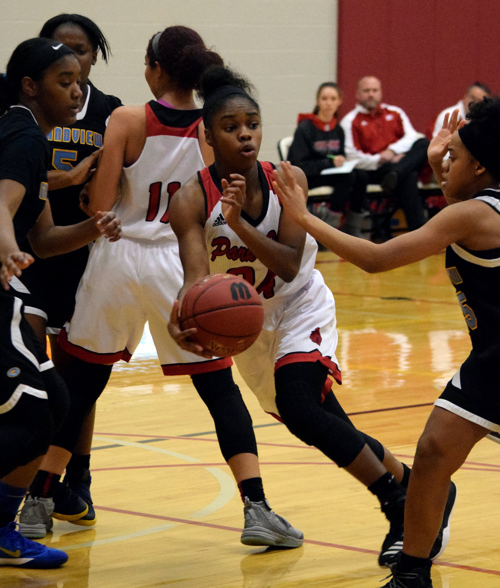 BRYCE MERENESS/Special to The Citizen Park Hill senior Taiya Shelby drives through traffic against Grandview in a Winnetonka Invitational first round game Monday, Nov. 27 in Kansas City, Mo.