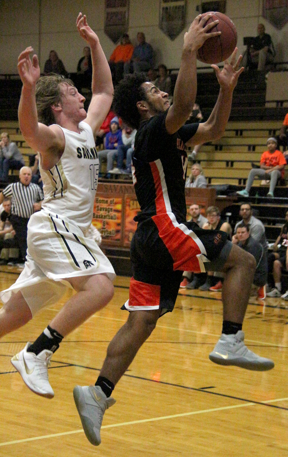 ROSS MARTIN/Citizen photo Platte County senior Kobe Cummings, right, goes up for a layup in the second half against Savannah on Monday, Nov. 27 in Savannah, Mo.