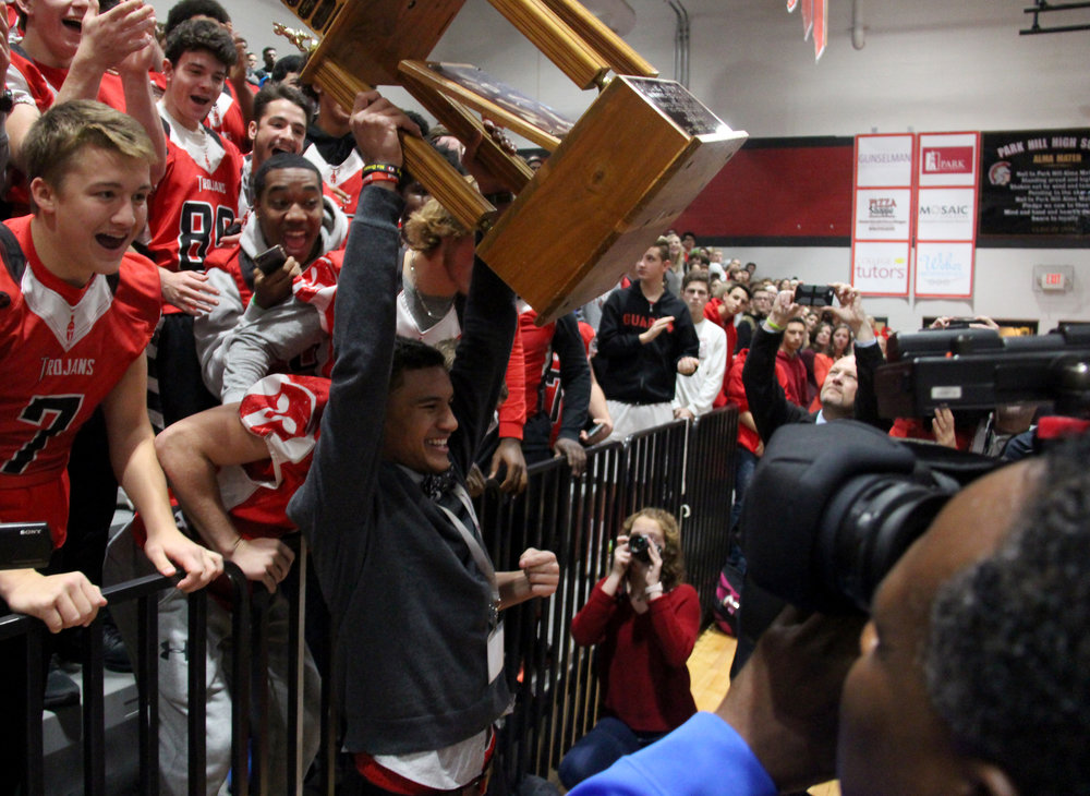 ROSS MARTIN/Citizen photo Park Hill senior Ronnie Bell (center) lifts up the Simone Award trophy in front of his teammates during a ceremony Tuesday, Dec. 5 at Park Hill High School in Kansas City, Mo.