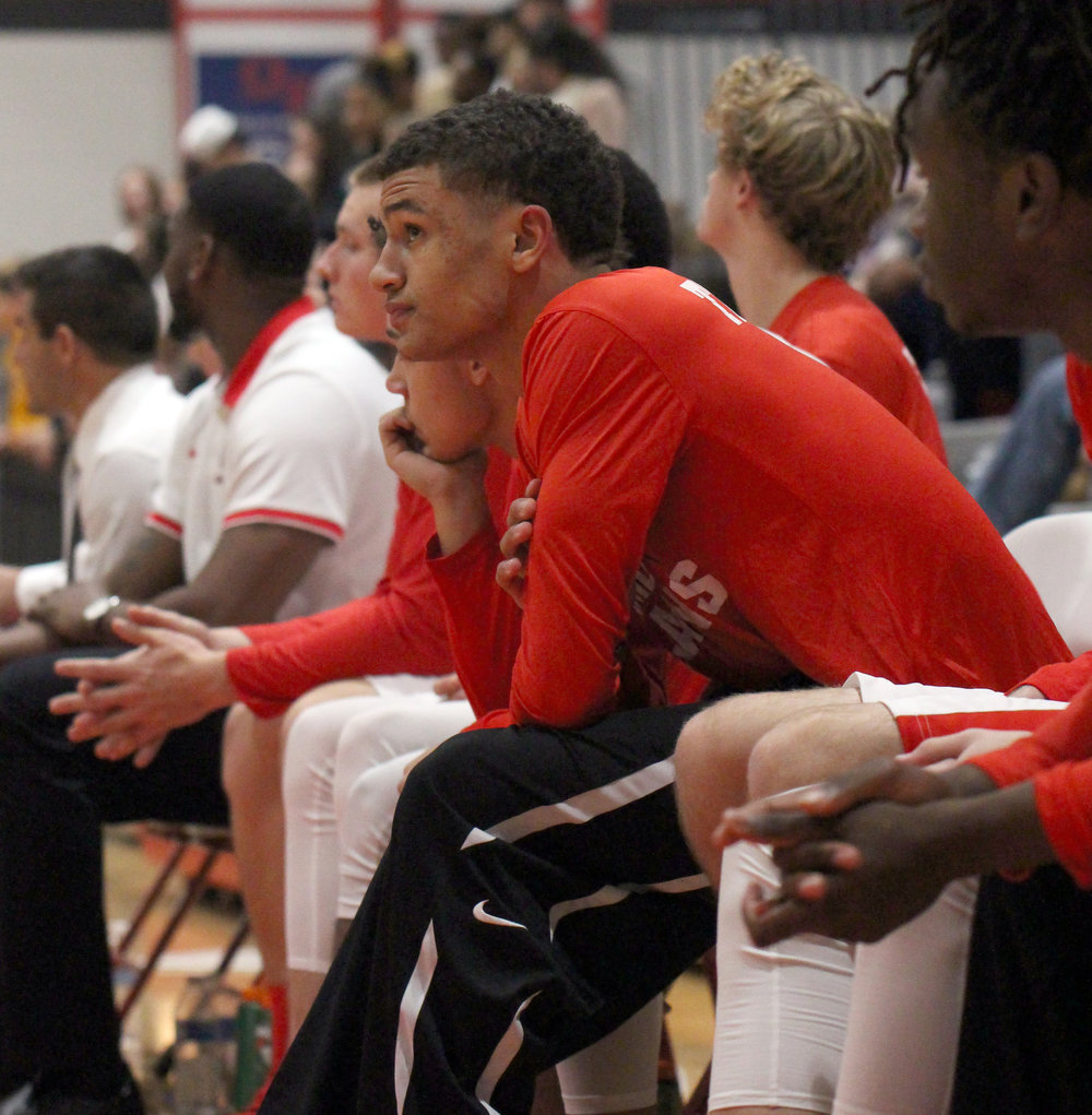 ROSS MARTIN/Citizen photo Park Hill senior Ronnie Bell watches from the bench Friday, Dec. 1 against North Kansas City at Park Hill High School in Kansas City, Mo. Bell was unable to play due to injury.
