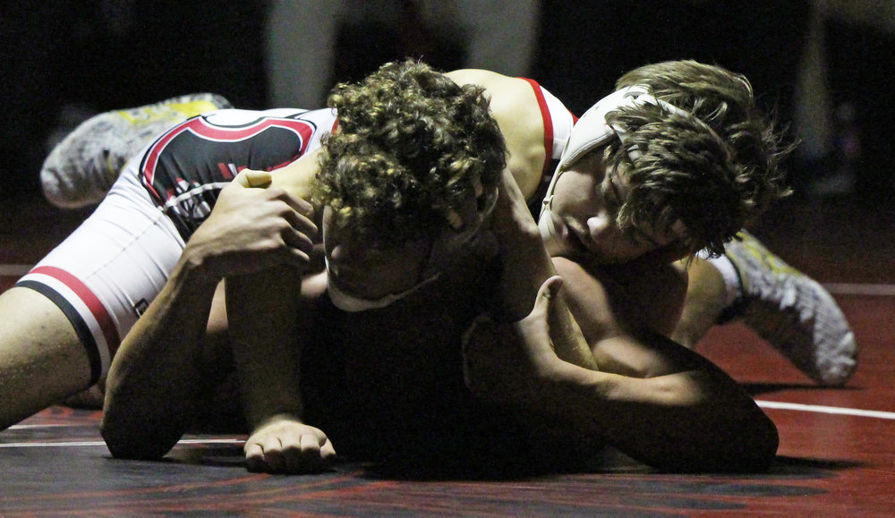 ROSS MARTIN/Citizen photo Park Hill junior Blake Hopson, top, works on top during a 170-pound match during a dual with Broken Arrow (Okla.) on Friday, Dec. 1 at Park Hill High School in Kansas City, Mo.