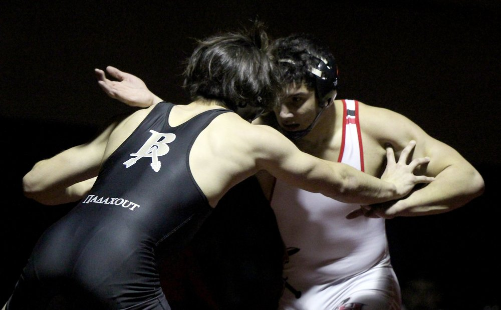 ROSS MARTIN/Citizen photo Park Hill sophomore Ashton Sharp, right, reaches out while grappling with his opponent in a 182-pound match against Broken Arrow (Okla.) on Friday, Dec. 1.