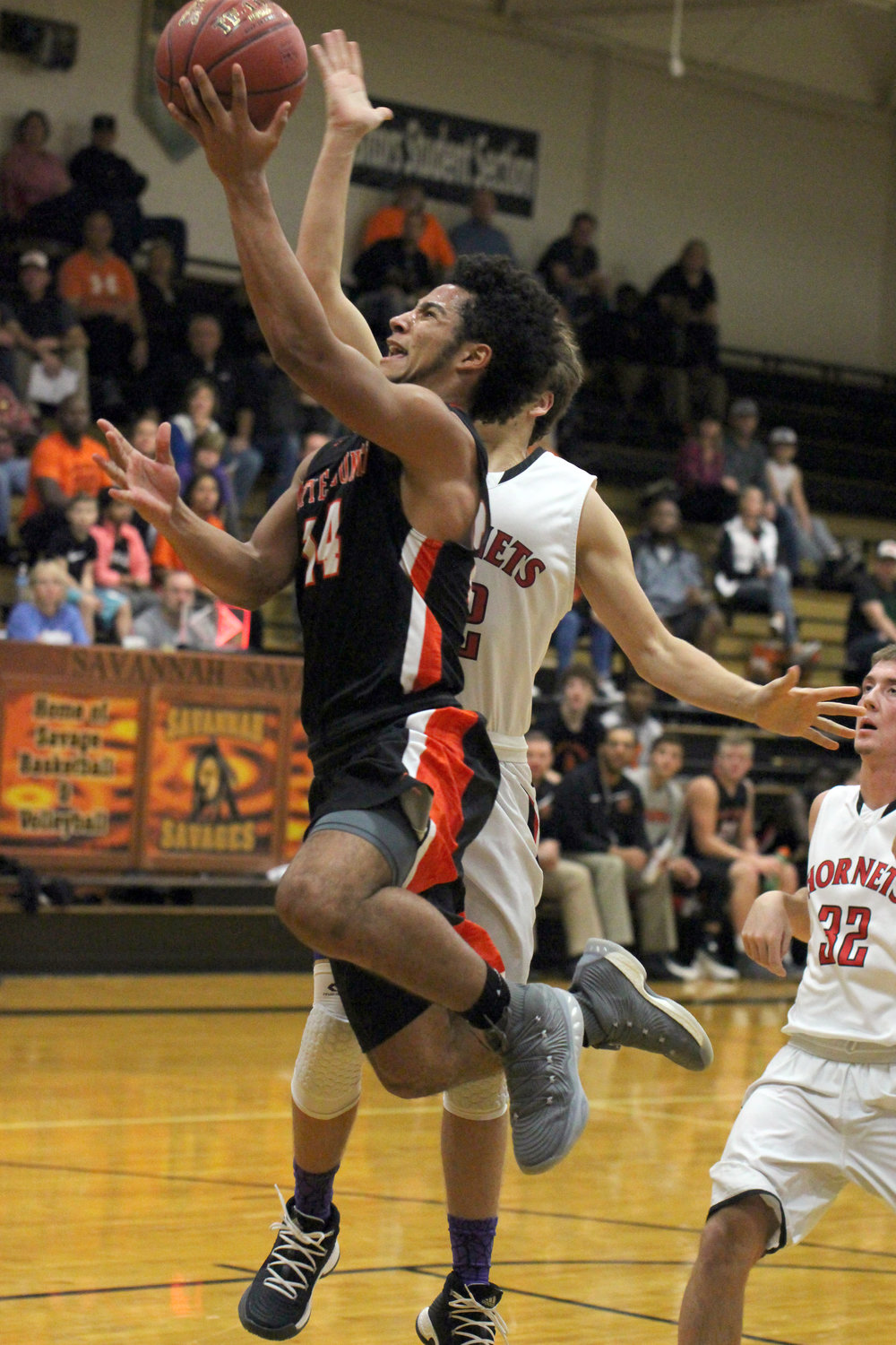 ROSS MARTIN/Citizen photo Platte County senior Kobe Cummings goes in for a layup just before the halftime buzzer against Chillicothe in the championship game of the 89th annual Savannah Invitational on Saturday, Dec. 2 at Savannah High School in Savannah, Mo. Platte County held on for a 50-49 win to claim its first tournament title since 2009.