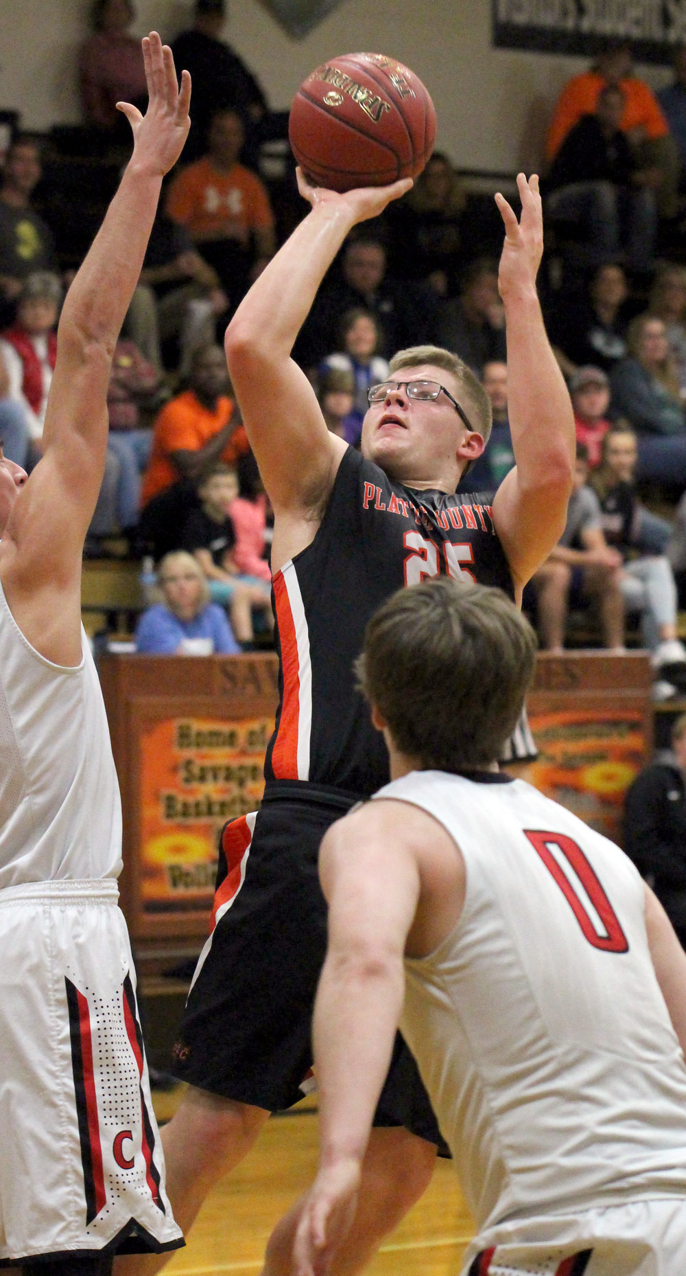 ROSS MARTIN/Citizen photo Platte County senior forward Lucas Stanley (25) takes a shot in the lane over a Chillicothe defender on Fr.
