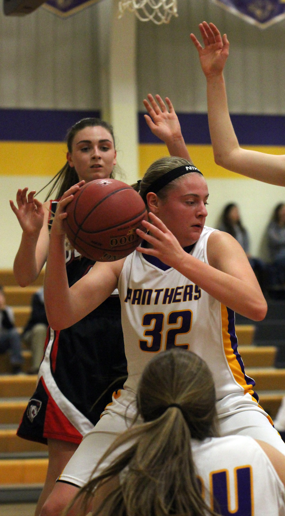 ROSS MARTIN/Citizen photo North Platte junior Grace Rice looks for room under the basket in a game against Northland Christian on Monday, Dec. 11 in Dearborn, Mo.