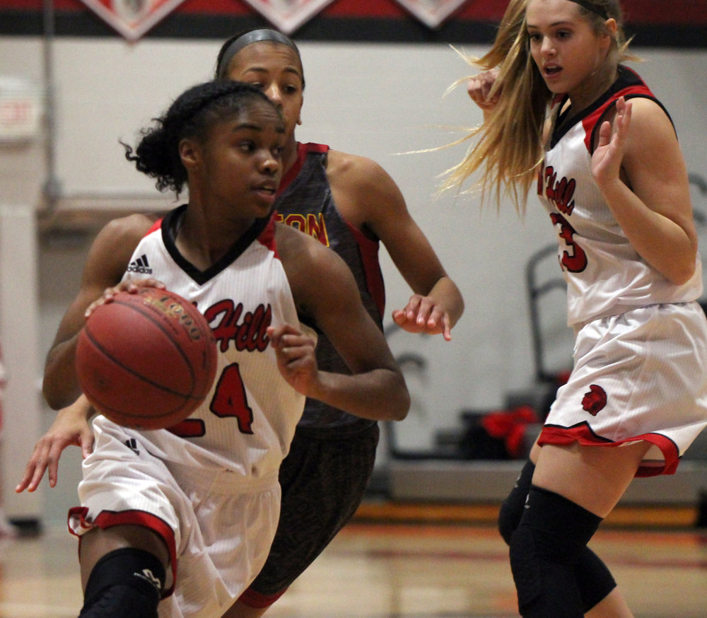 ROSS MARTIN/Citizen photo Park Hill senior Taiya Shelby, left, goes around a screen toward the basket against Benton on Thursday, Dec. 7 at Park Hill High School in Kansas City, Mo.
