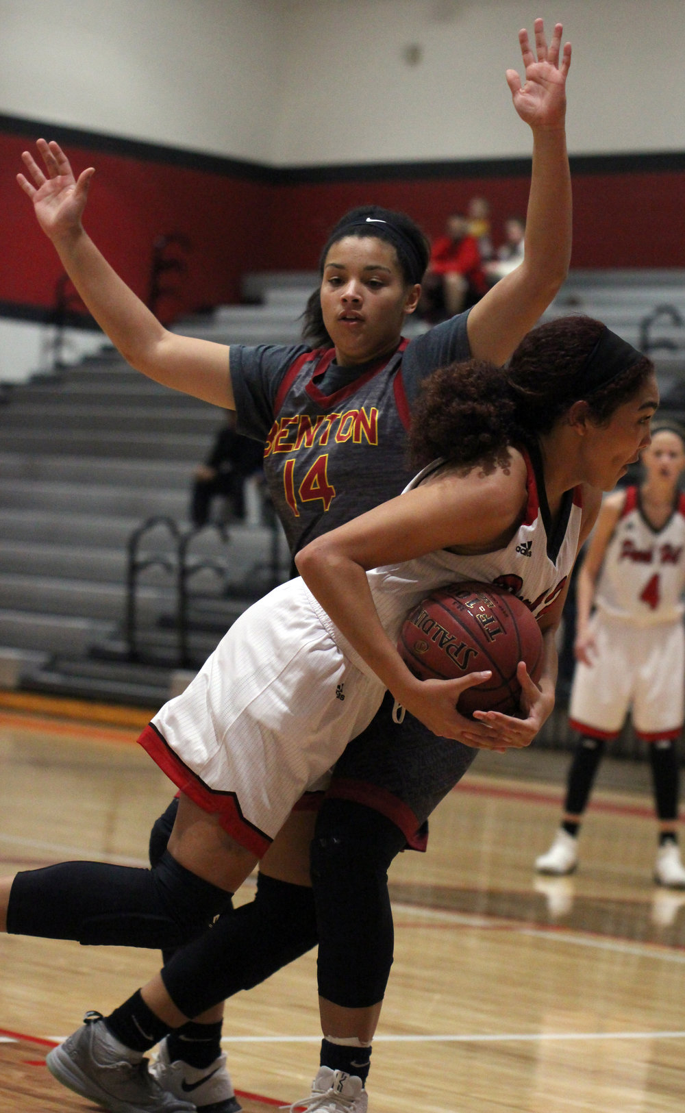 ROSS MARTIN/Citizen photo Park Hill junior Aleece Noble (front) draws a foul against Benton on Thursday, Dec. 7 at Park Hill High School in Kansas City, Mo.