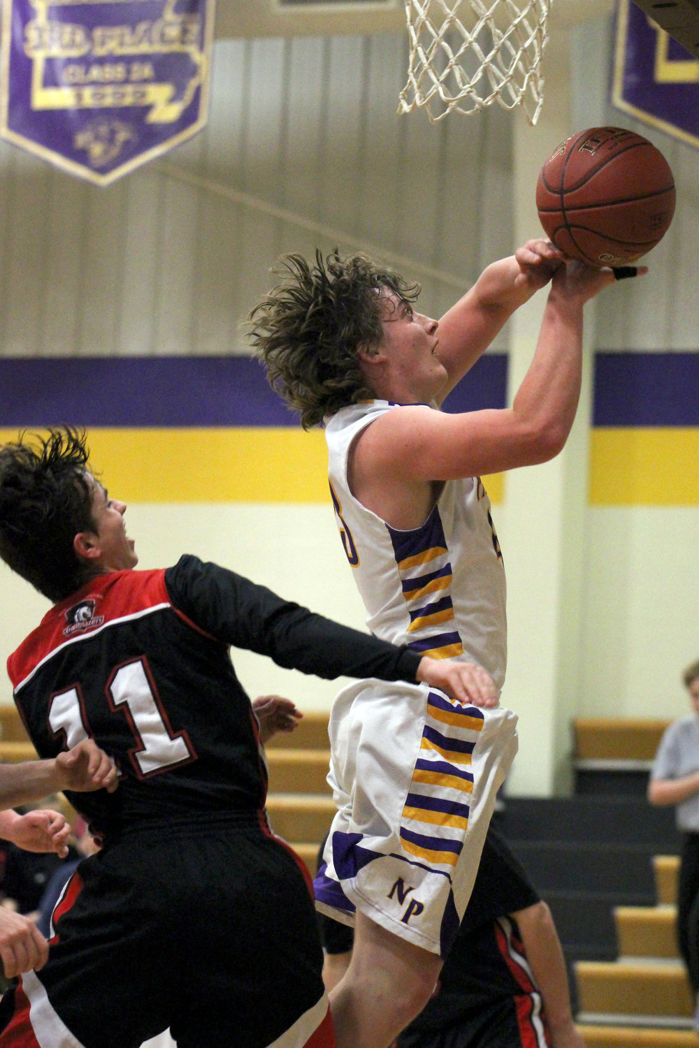 ROSS MARTIN/Citizen photo North Platte junior Jesse Martin draws a foul while going up for a shot against Northland Christian on Monday, Dec. 11 at North Platte High School in Dearborn, Mo.
