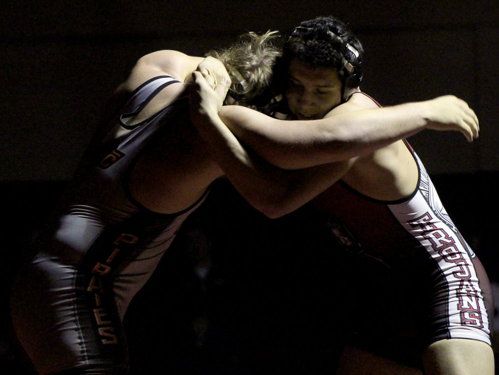 ROSS MARTIN/Citizen photo Platte County senior Sage Smart, left, and Park Hill sophomore Ashton Sharp fight for position during a 220-pound match in a dual Tuesday, Dec. 5 at Park Hill High School in Kansas City, Mo.