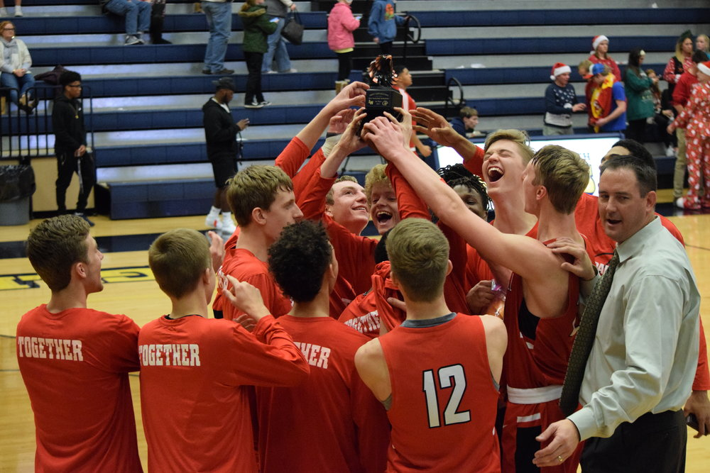 BRYCE MERENESS/Special to The Citizen Park Hill players and coach Chad Jones celebrate after winning the Liberty North Invitational championship game over Liberty North on Saturday, Dec. 9 at Liberty North High School in Liberty, Mo.