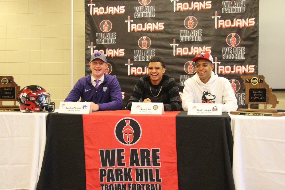 ROSS MARTIN/Citizen photo Park Hill seniors (from left) Randen Plattner, Ronnie Bell and Devin Haney signed scholarships to play Division I football during a ceremony Wednesday, Dec. 20 at Park Hill High School in Kansas City, Mo.