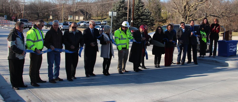 ROSS MARTIN/Citizen photo Officials gathered together for a ribbon-cutting ceremony Wednesday, Dec. 13 to honor the opening of an expanded four-lane section of Highway 45, running from Route K to Interstate 435 in Parkville, Mo. The project took about five years to complete after grant money was secured in 2012. The construction process lasted more than a year.