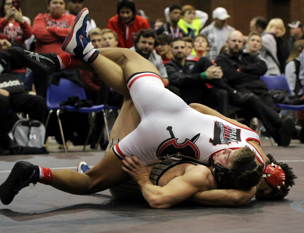 ROSS MARTIN/Citizen photo Park Hill senior Devin Winston, top, pins Neosho's Joey Williams in the 182-pound championship match of the Kansas City Stampede tournament on Saturday, Dec. 16 at Hale Arena in Kansas City, Mo.