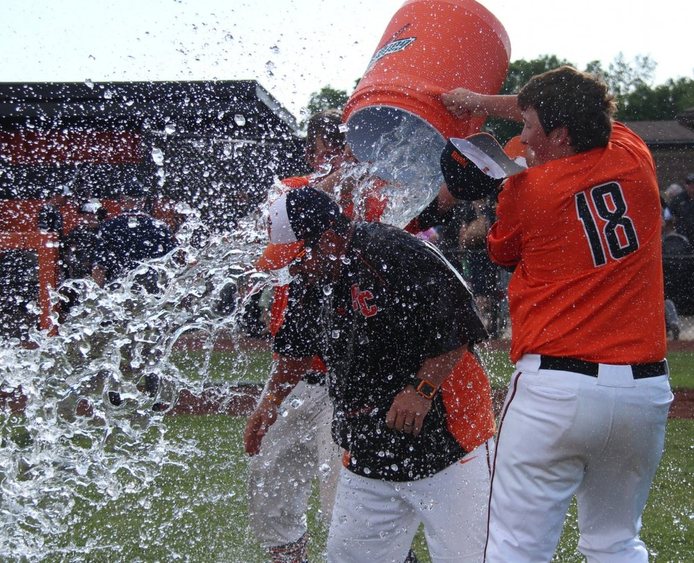Citizen file photo Platte County sophomore Glen Gammill, right, and senior Grant Carver, rear, dump ice and water on coach Rob Davenport after the Pirates' 10-0 win over Staley in the Class 5 District 16 championship game Wednesday, May 17 at Platte County High School.