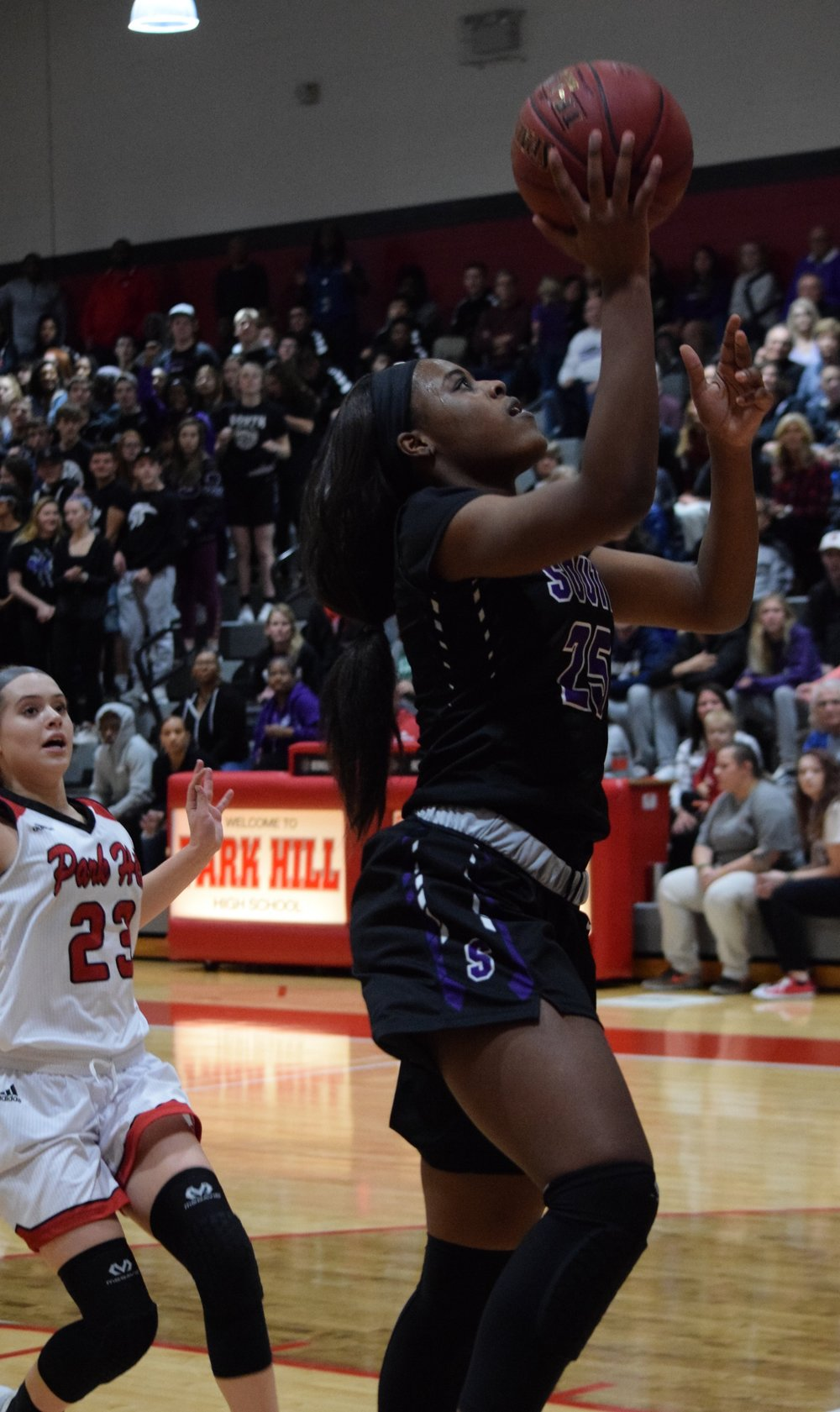 BRYCE MERENESS/Special to The Citizen  Park Hill South junior forward Alecia Westbrook goes in for a layup against Park Hill on Wednesday, Dec. 20 at Park Hill High School in Kansas City, Mo.