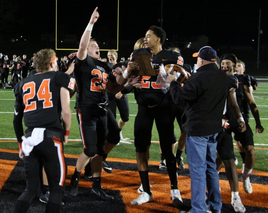 Citizen file photo Platte County seniors and all-state selections (from left) JP Post, Dakota Schmidt and John Watts grab the Class 4 District 8 championship plaque after a win over Lafayette this past season at Pirate Stadium.