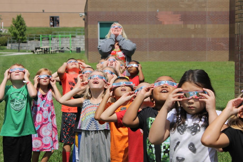 Contributed photo Members of Mrs. Pickett's second grade class at Pathfinder Elementary in Platte City test out solar eclipse glasses Monday, Aug. 21 before clouds moved into the area and hampered viewing of the event.