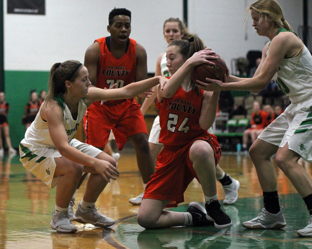 CODY THORN/Citizen photo Platte County junior forward Meghan Amos, center, battles for a rebound while Smithville defenders Leah Bultmann, left, and Malea Langhus, right, and teammate Rockey Chambers converge on the play during a game Monday, Jan. 8, at Smithville High School in Smithville, Mo. The Pirates won 63-47 to snap an 11-game losing streak against the Warriors that dated back to 2010.