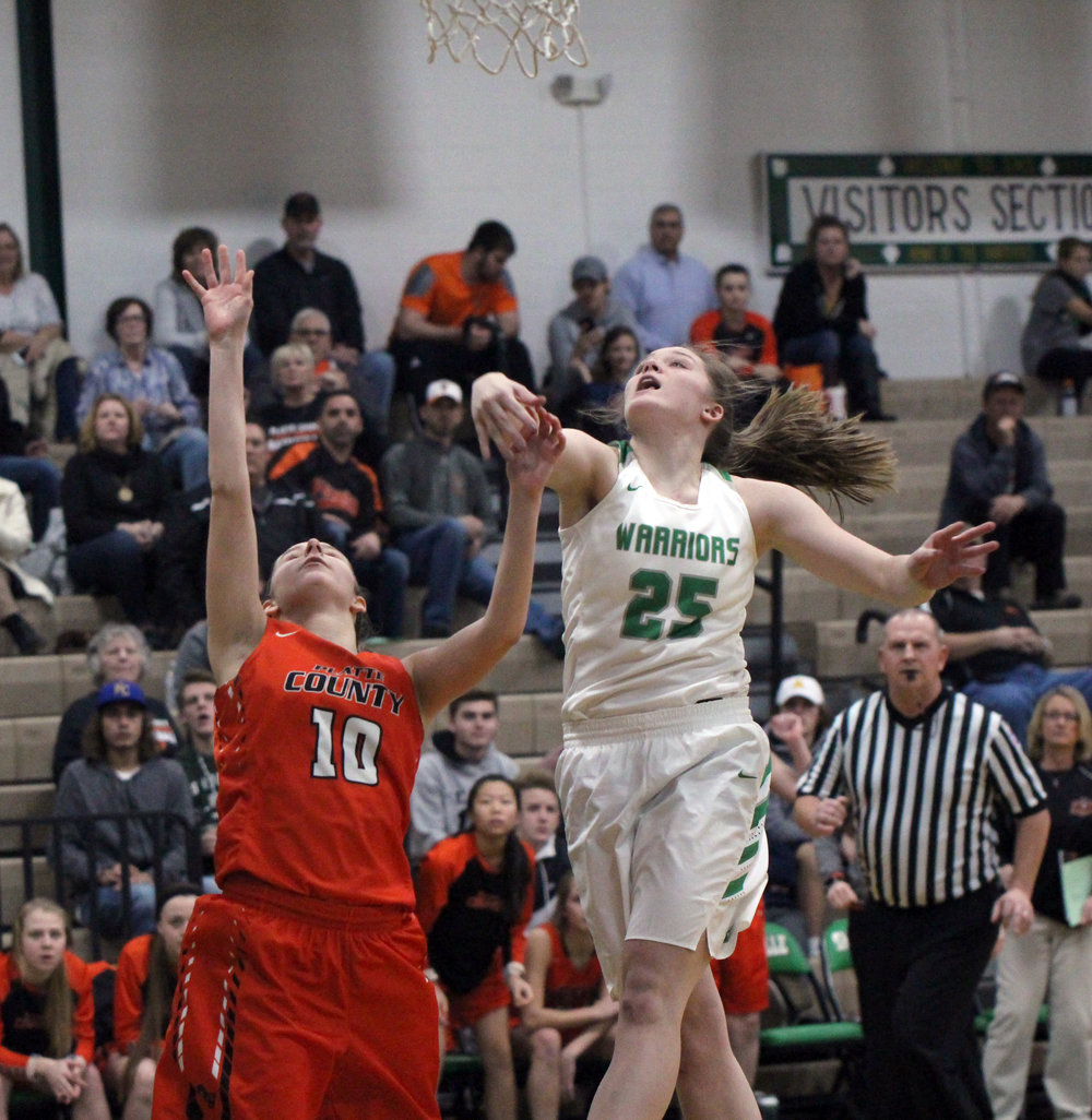 CODY THORN/Citizen photo Platte County guard Hannah Valentine shoots a jumper over a Smithville defender during a game Monday, Jan. 8, in Smithville, Mo.