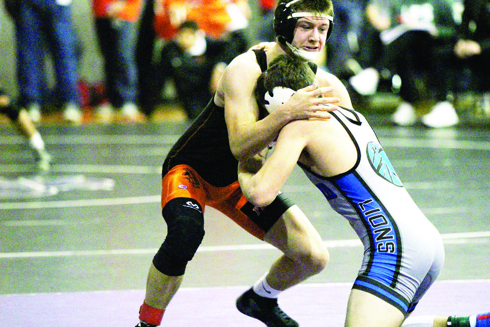 Cody Thorn/Citizen Photo Platte County's Nick Filger battles Cayleb Atkins of Goddard, Kan., in a fifth-place match at the Bobcat Classic in Basehor, Kan. Atkins won the match by a pin on Saturday, Jan. 13.