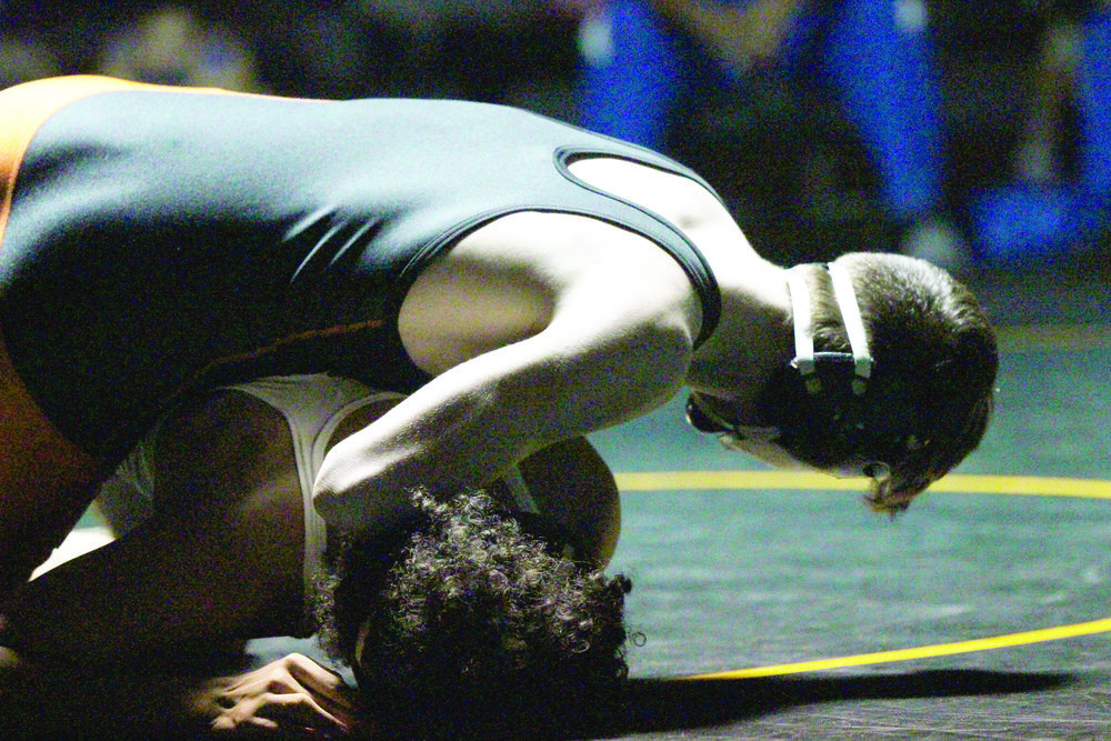 CODY THORN/Citizen photo Platte County senior Cody Phippen, top, works to cradle Kansas City Schlage's Mason Turner in the championship match of the 126 pound class in the Basehor-Linwood Bobcat Classic on Saturday, Jan. 13 in Basehor, Kan.