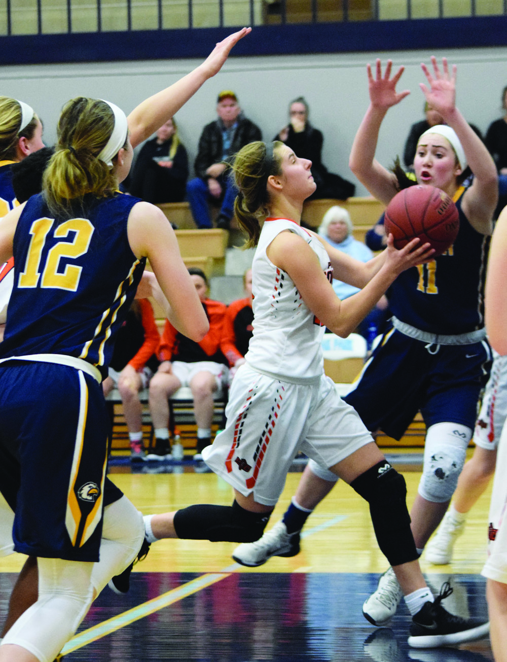 BRYCE MERENESS/Citizen photo Hannah Valentine, center, drives the lane for the winning layup in Platte County's 45-44 win against Liberty North in the first round of the Oak Park Invitational on Monday, Jan. 15.