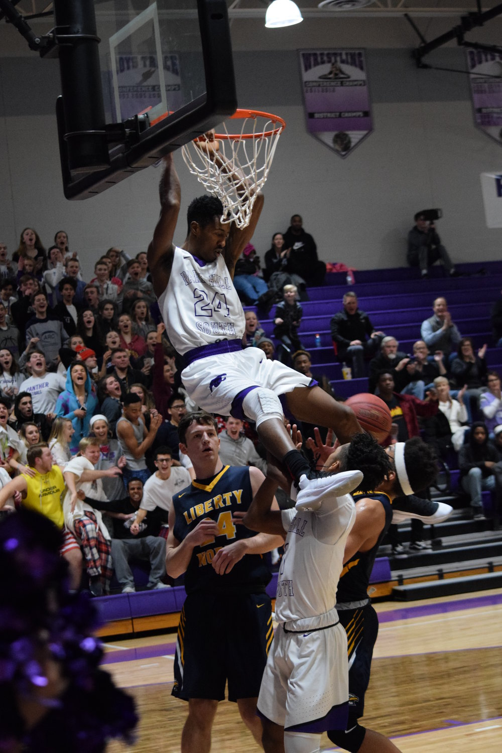 BRYCE MERENESS/Citizen photo Park Hill South senior Saadique Perkins  looks for a safe landing spot after a dunk in the Panther 60-56 loss to Liberty North  in Park Hil South's Suburban Conference opening game on Friday, Jan. 12 at Park Hill South  High School.