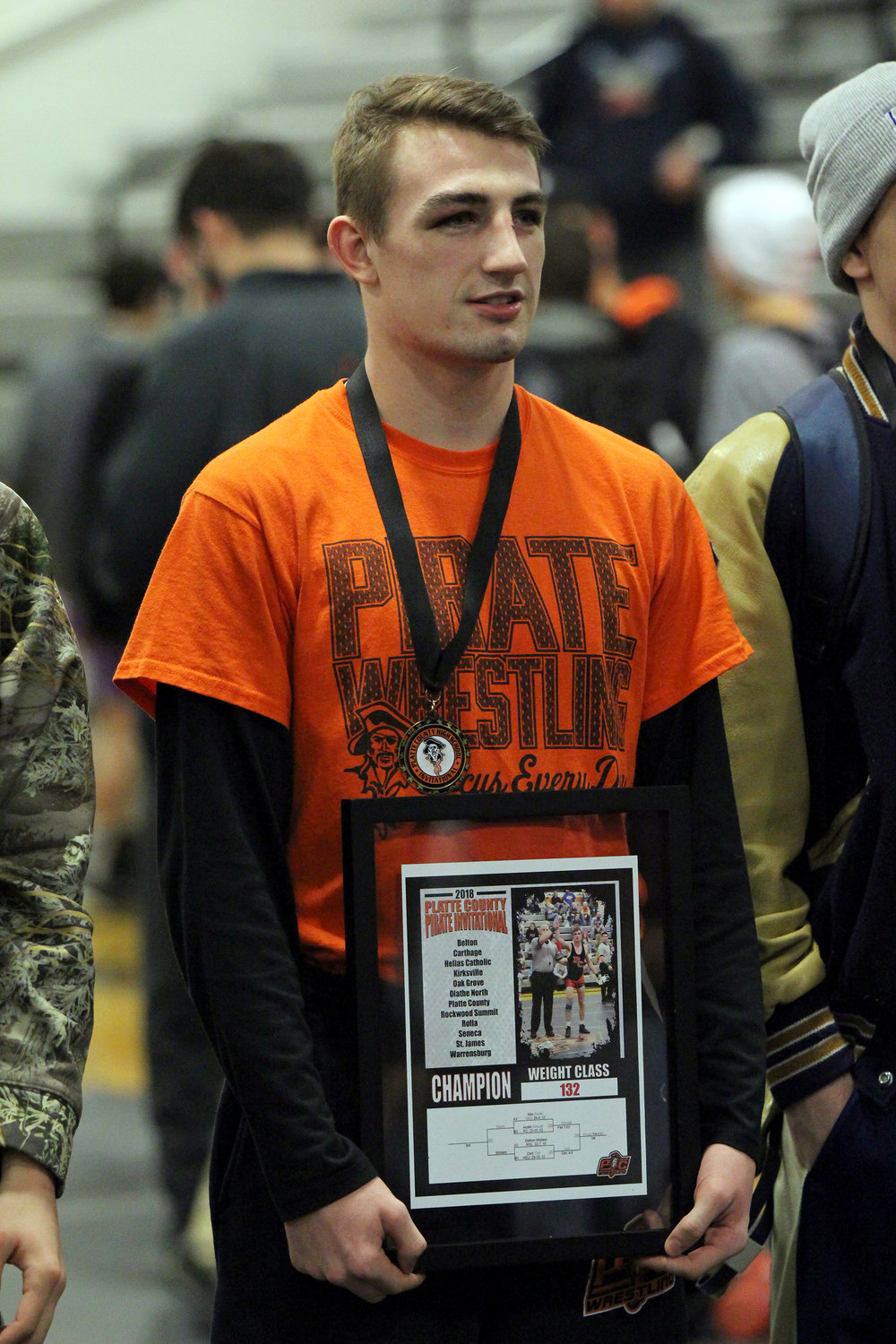 Cody Thorn/Citizen Photo Platte County senior Austin Kincaid holds the plaque for winning the championship at the Platte County Invitational on Saturday, Jan. 20, at Platte County High School.