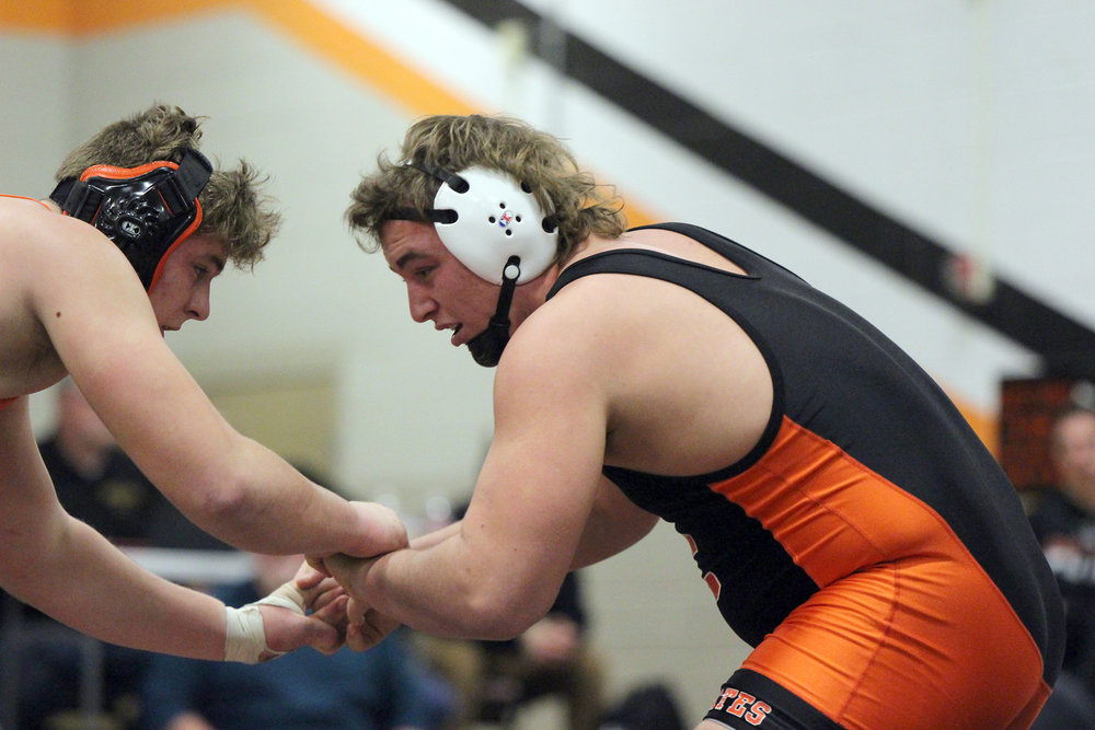 CODY THORN/Citizen photo Platte County's Sage Smart, right, locks hands with Kirksville's Colton Gillespie in a pair of state-ranked foes battling for the 220-pound championship on Saturday, Jan. 20, at the Platte County Invitational.