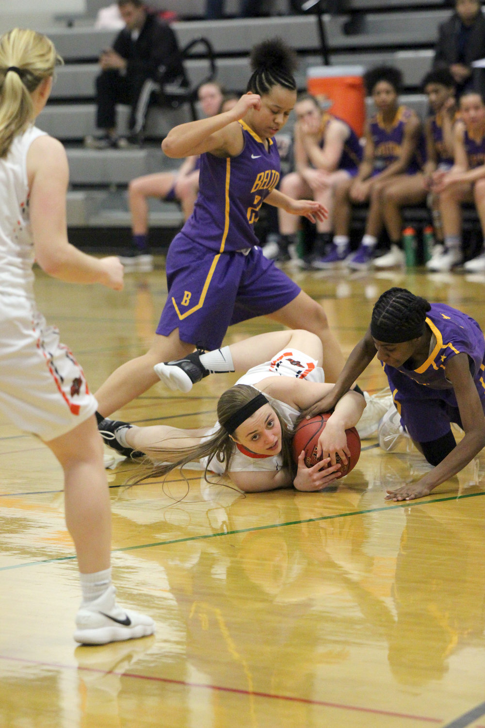 CODY THORN/Citizen photo Platte County junior Trista Amos, middle, looks up at a referee who called a jump ball situation after she battled Belton's Ta'Kyla Canady for the loose ball during a game Monday, Feb. 5, at Platte County High School.