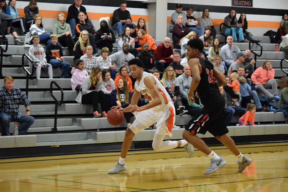 BRYCE MERENESS/Citizen photo Platte County's John Watts, left, dribbles around Raytown South's Caleb Jones-McCrary during a game Friday, Feb. 2, at Platte County High School. The Class 4 No. 10-ranked Raytown South squad won 67-50 against the Pirates.