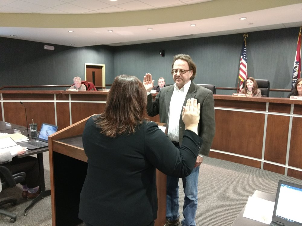 JEANETTE BROWNING FAUBION/ Citizen photo Phil Wassmer is sworn in by Parkville city clerk Melissa McChensey as the new ward one alderman during a meeting held on Tuesday, Feb. 6, at Parkville City Hall.