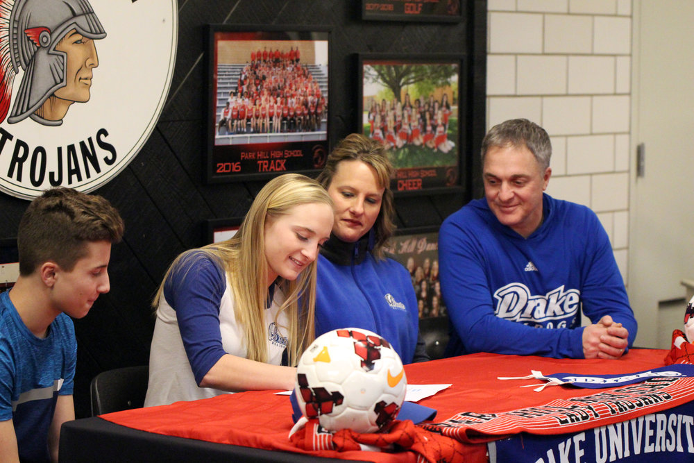 CODY THORN/Citizen Photos Park Hill soccer player Alison Walls signs her letter of intent to play at Division I Drake University in Des Moines, Iowa.