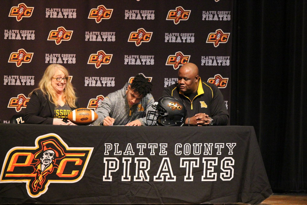 Kobe Cummings, center, will play baseball and football at Missouri Western.
