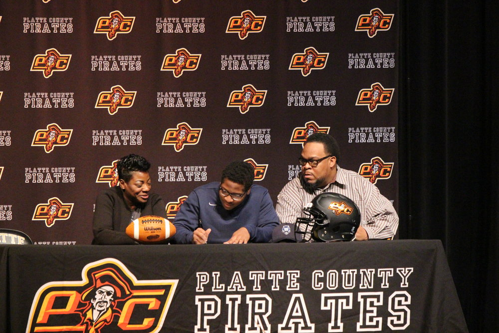 Michael Smith, center, will play football at Lincoln University in Jefferson City, Mo.
