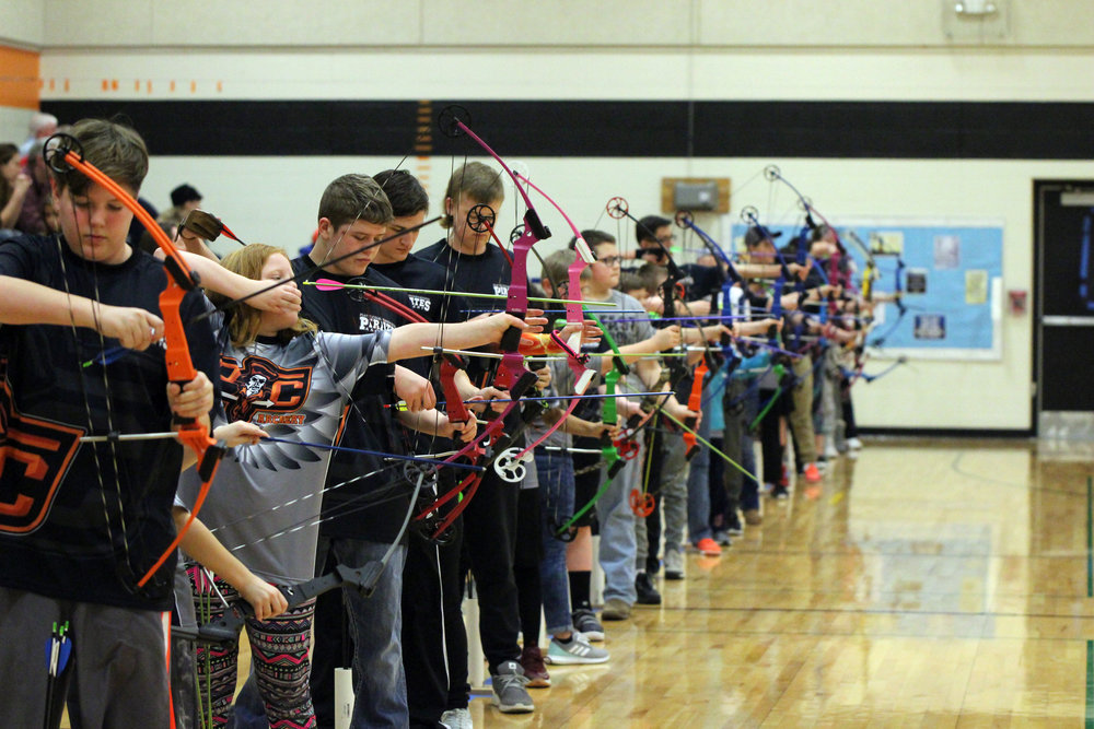 CODY THORN/Citizen photo Archers from all grade levels prepare to shoot during competition of the Platte County Archery Tournament on Saturday, Feb. 3, at Barry School in the Platte County R-3 School District in Kansas City, Mo.