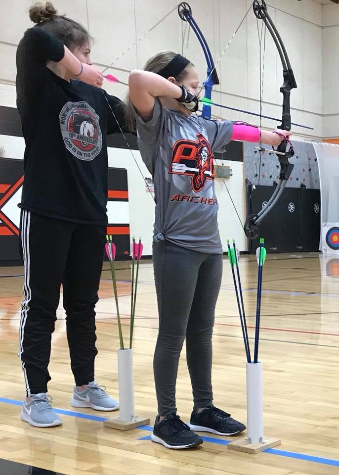 Contributed photo Siegrist students Adi Benninghoff and Brianna Clowser prepare to shoot during the North of the River meet on Saturday, Feb. 10.